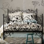 Black Metal Bed Frame, White Flowery Wallpaper, Grey Seamless Floor,