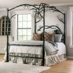 Black Metal Bed Platform With Branches Above, Wooden Floor, White Wall, White Wooden Cabinet, White Rug