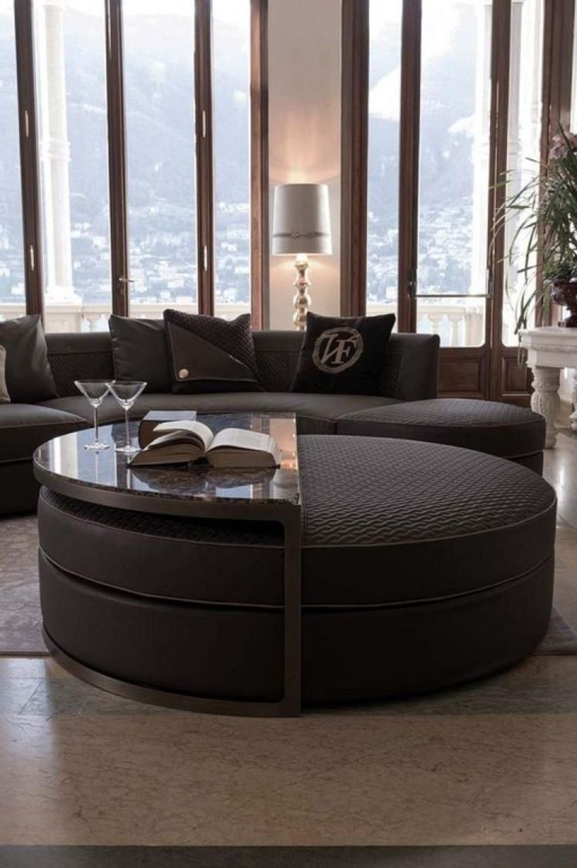 black round leather, black half round marble, black leather sofa, grey rug, windows