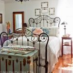Brown Copper Metal Bed Frame, White Wall, Green Traditional Chandelier, Wooden Floor, Green Wooden Chest, Wooden Side Table, Table Lamp