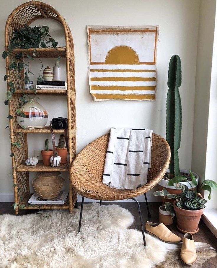 corner, black floor, white wall, rattan rond chair, white fur rug, rattan shelves
