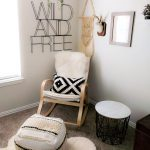 Corner Room, Grey Rug, White Wall, Rocking Chair, White Cushion, White Ottoman, Black Metal Stool
