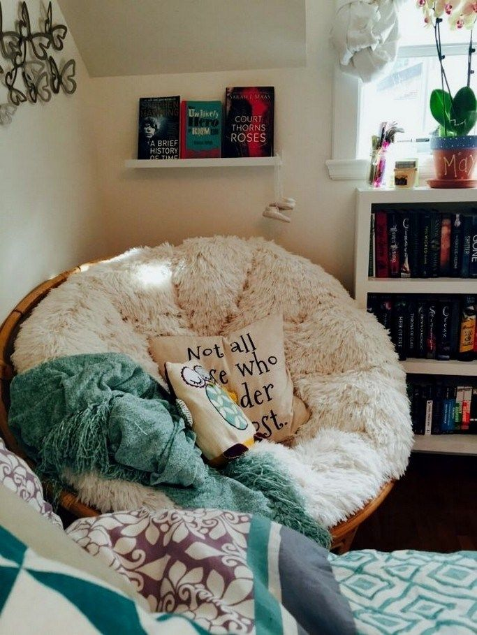 corner, white shelves, rattan chair, white cushion