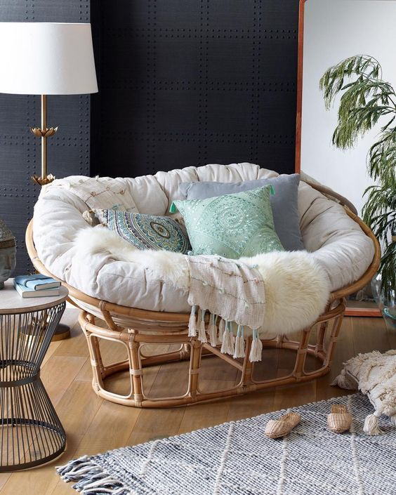 corner, wooden floor, black wall, white wall, round side table, papasan chair white cushion, rattan chair