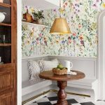 Dining Corner, Flowery Wallpaper, White Floating Shelves, Wooden Round Tulip Table, Grey Wooden Corner Bench