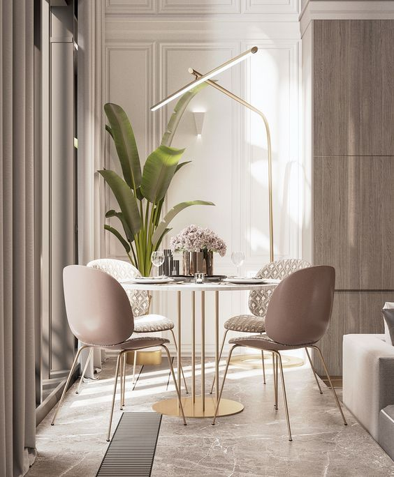 dining room, brown marble floor, white wall, soft pink chairs, white round golden legs, golden floor lamp