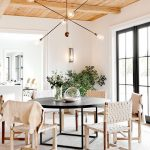 Dining Room, Floor Rug, White Wall, Wooden Ceiling, Line Pendant, Black Round Table, White Leather Wooden Chairs