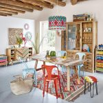 Dining Room, Grey Floor Tiles, White Wall, Wooden Beams, Wooden Table, Patterned Rug, Blue Red Chairs, Patterned Pendant, Wooden Cabinet, Colorful Cabinet