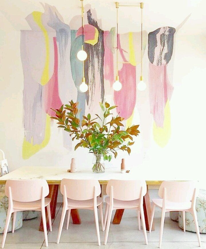 dining room, white floor, watercolor wallpaper, white table, pink chairs, lighting fixtures