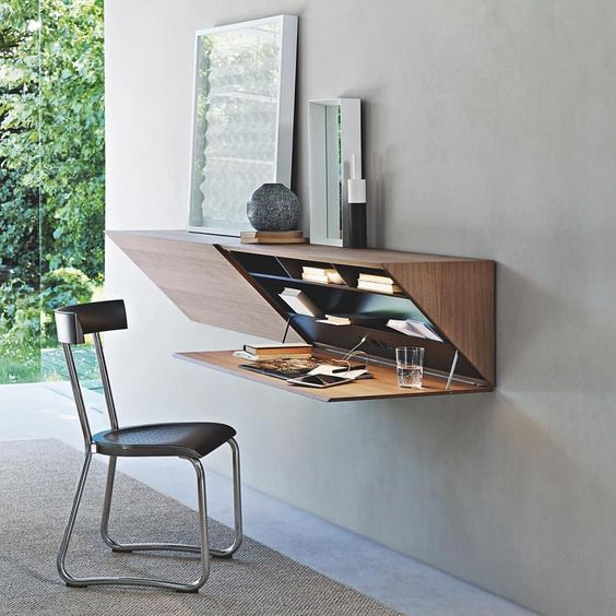 floating table, wooden material, prism shape, opened door, grey wall, black chair, grey flor, grey floor