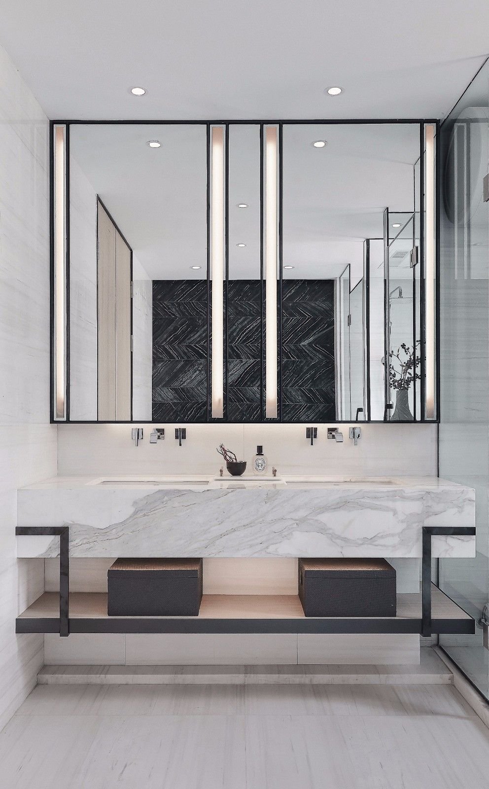floating vanity, white marble table, black sheles, marble wall, black framed mirror, white marble floor