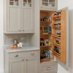 Grey Cupboard, Grey Marble Counter Top, Wooden Shelves On The Door