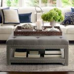 Grey Ottoman With Nailhead Details On The Side, Shelves Under, Rattan Tray, White Sofa, Grey Rug