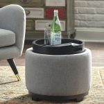 Grey Round Ottoman, Black Tray, Grey Sofa, Wooden Floor, Yellow Rug