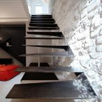 Grey Stairs With Installation On The Wall, White Exposed Wall