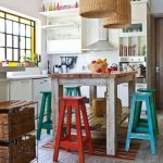 Kitchen, Wooden Floor, White Bottom Cabinet, White Subway Tiles, Rattan Pendants, Wooden Table, Blue Red Wooden Stools,