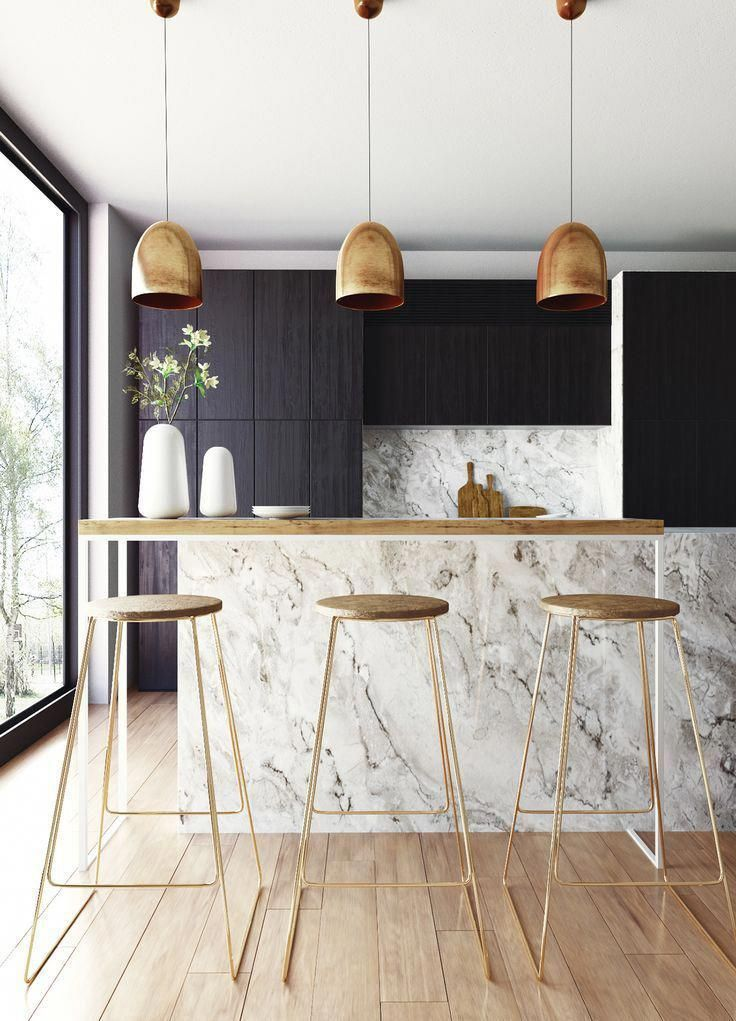 kitchen, wooden floor, white marble island, black cabinet, white marble backsplash, golden pendants, golden stools, wooden top