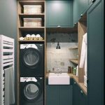 Laundry Room, Dark Green Cabinet, Stacked Black Machines, Rattan Basket, Shelves, White Sink