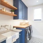 Laundry Room, Patterned Floor, White Wall, White Subway Tiles, Blue Cabinet, Wooden Shelves, White Apron Sink