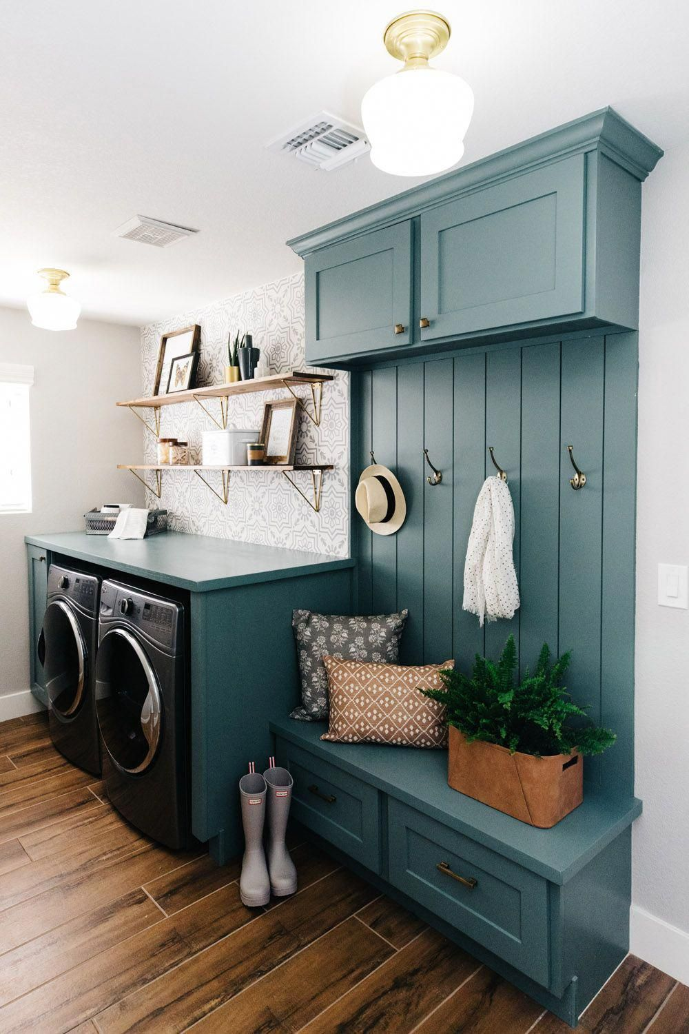 laundry room, wooden floor, dark green wooden board wih cabinet, drawers, floating shelevs