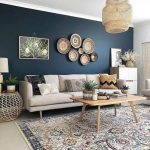 Living Room, Grey Floor, Patterned Rug, Wooden Table, Blue Wall, Grey Sofa, Rattan Pendants, Wooden Cabinet