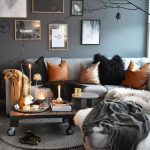 Living Room, Grey Wall, Grey Rug, Grey Sofa, Wooden Coffee Table With Roll, Grey Ottoman