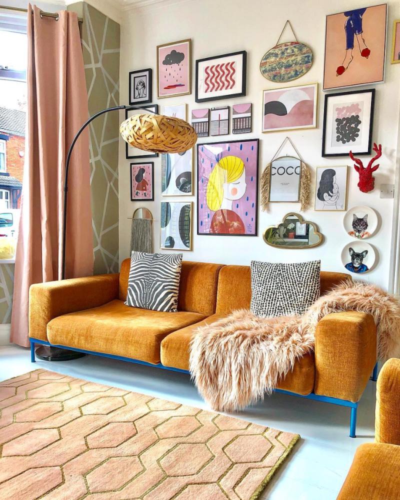living room, light blue floor, brown rug, cream wall, rattan floor lamp, pictures