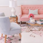 Living Room, Pink Flowery Rug, White Ottoman, Grey Chair, Pink Sofa, Rattan Coffee Tbale, Rattan Side Table, White Wainscoting