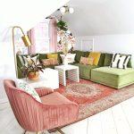 Living Room, White Wooden Floor, White Sloped Ceiling, Red Patterned Rug, Pink Chair, Green Velvet Sofa, White Coffee Table