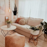 Living Room, Wooden Floor, Cream Wall, Cream Sofa, Marble Round Coffee Table, Brown Ottoman, Rattan Side Table, White Curtain