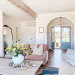 Living Room, Wooden Floor, White Wall, Blue Door, Pink Velvet Chairs, Wooden Coffee Table, Cream Sofa