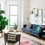Living Room, Wooden Floor, White Wall, Blue Tufted Sofa, Grey Chair, Patterned Rug