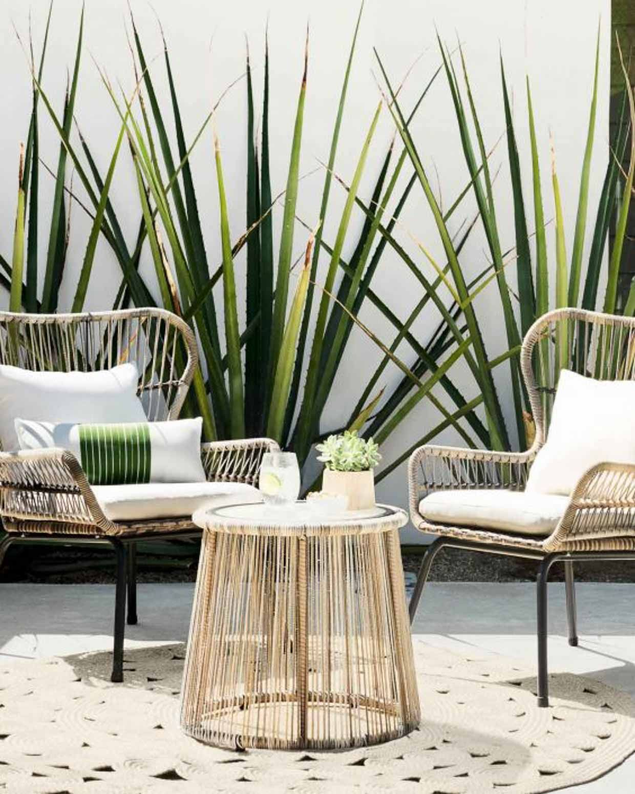 rattan chairs, rattan coffee table, patterned rug, grey floor