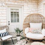 Rattan Chairs With White Cushion, Exposed White Wall, Wooden Floor, Rattan Chair With White Cushion, Rattan Ottoman, Rattan Rug