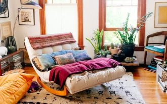 rocking sofa, wooden floor, white sofa, white patterned rug