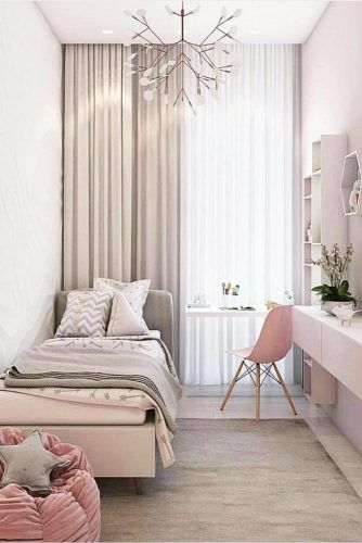small bedroom, white wall, pink floating cabinet, white study table, pink modern chair, brown floor, pink bed plaform