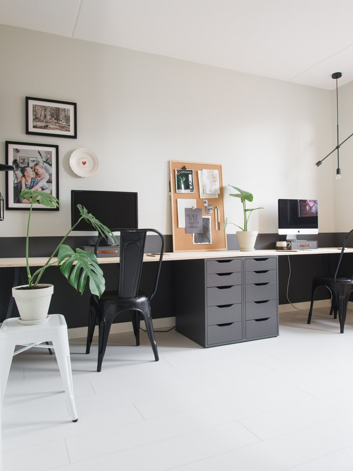 study room, seamless white floor, white wall, black cabinet, white table, black chair, white stool