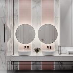 White Floating Vanity, Grey Floor Tiles, White Marble Wall, Pink Accent Vertical Lines On The Wall, White Sinks, Round Mirrors