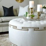 White Tufted Round Ottoman, Grey Sofa, Grey Rug, White Wall, Clear Tray