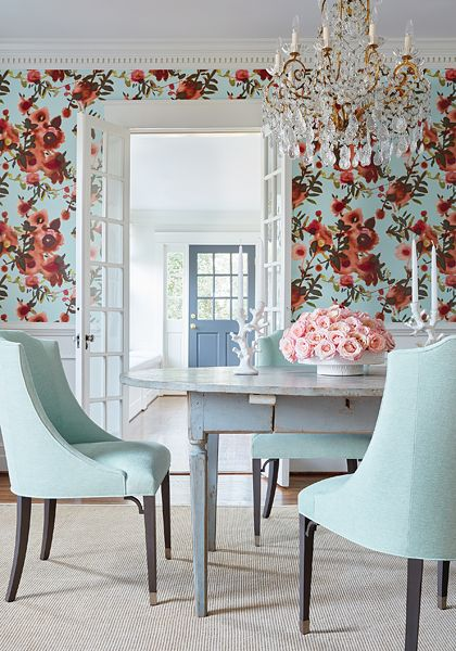 wooden floor, flower wallpaper, blue chair, blue wooden table, crystal chandelier