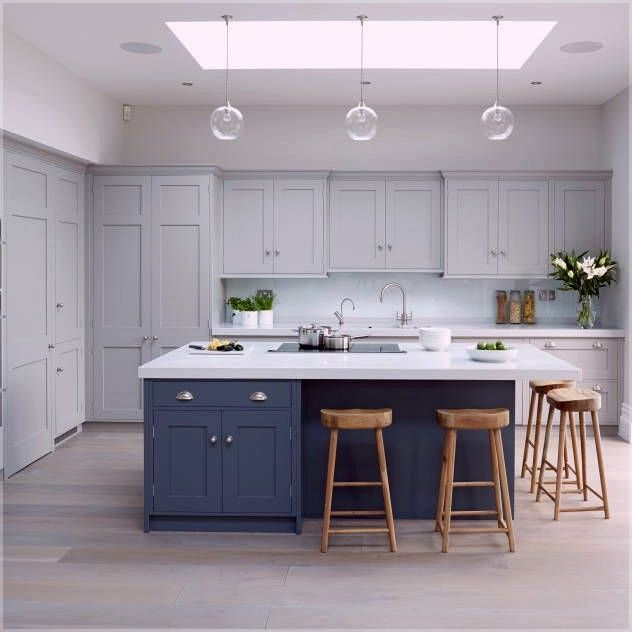 accent ceiling, ceiling window, white ceiling, glass bulb pendants, white kitchen cabinet, blue cabinet with white top, wooden stools
