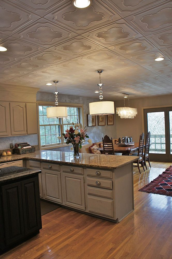 accent ceiling, pop corn ceiling, cream wall, cream kitchen cabinet, marble top, white pendants, lighting fixturejg