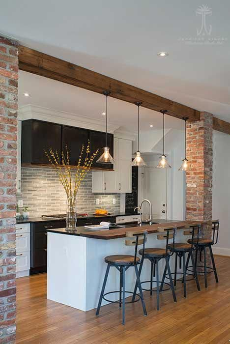 accent ceiling, white ceiling, wooden beam, expose brick wall, black kitchen cabinet, white island, black top, black iron chair with wooden seat