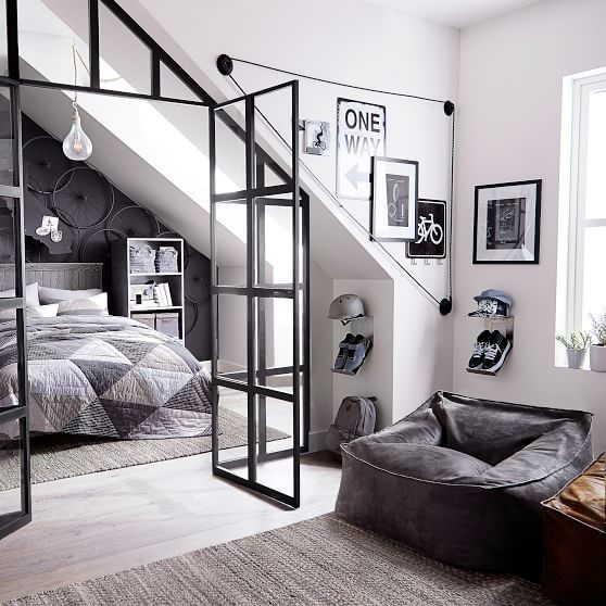 apartment, wooden floor, vaulted ceiling, glass window, black bean bag, grey bed
