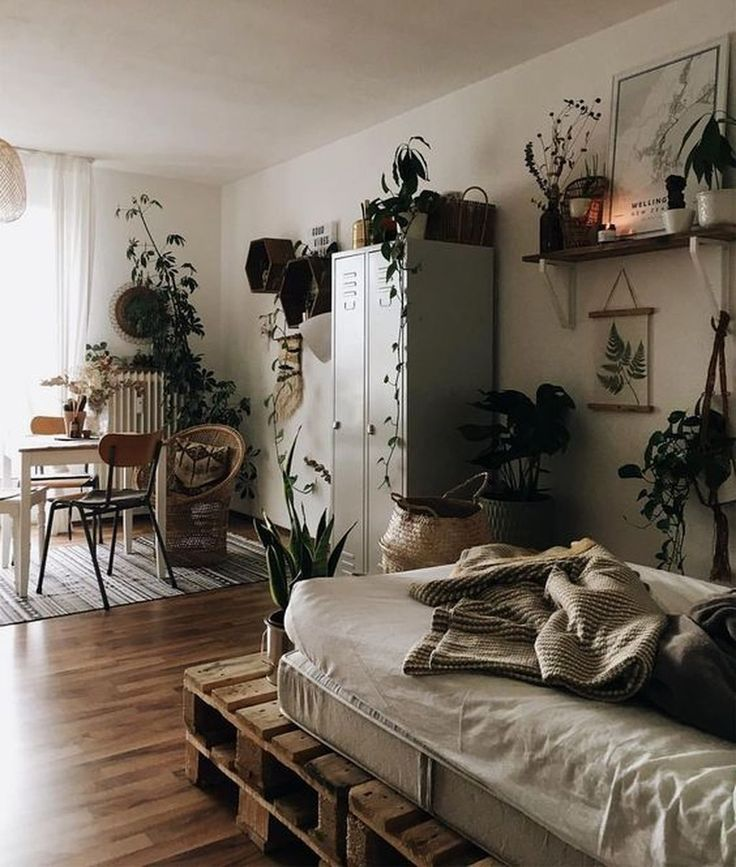 apartment, wooden floor, white wall, wooden bed platform, white dinign table, wooden chairs, floating shelves, metal cabinet