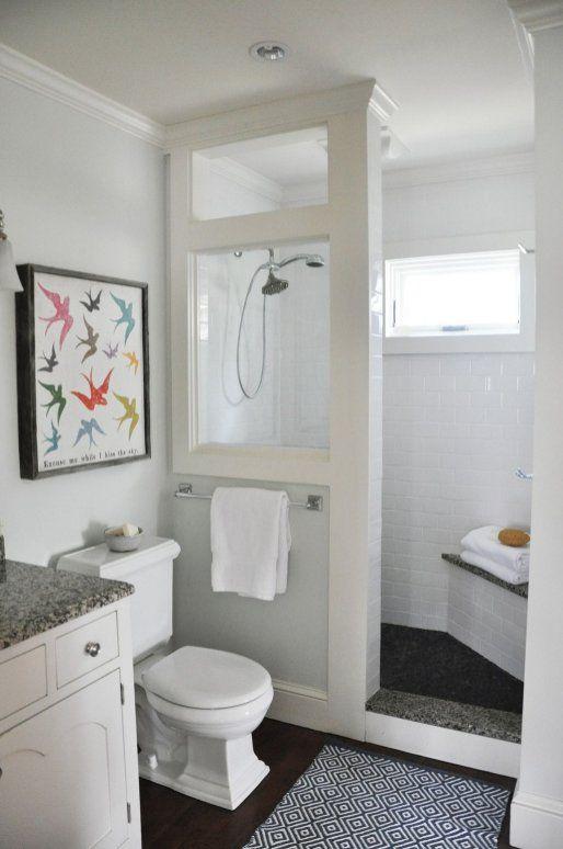 bathroom, black floor, white subway tiles, white toilet, white cabinet, grey marble top