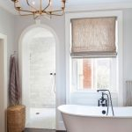 Bathroom, Dark Wooden Floor, White Wall, White Tub, Modern Chandelier, Curtain