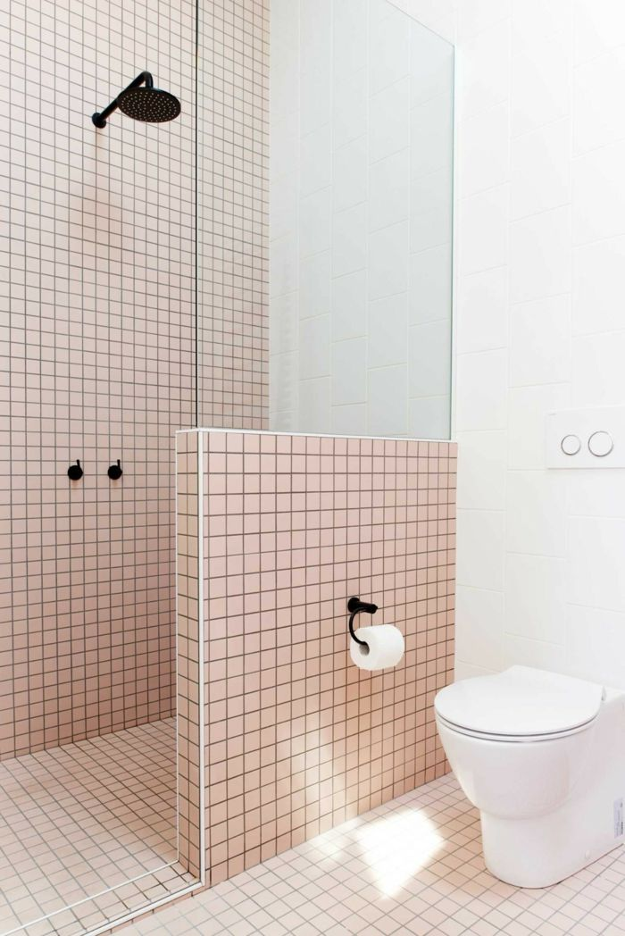 bathroom, light pink square tiles, white toilet, glass partition