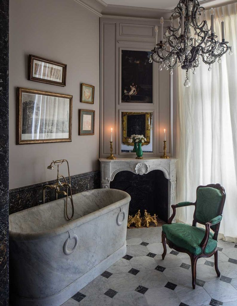 bathroom, marble floor, grey wall, dark grey marble, white fireplace, chandelier