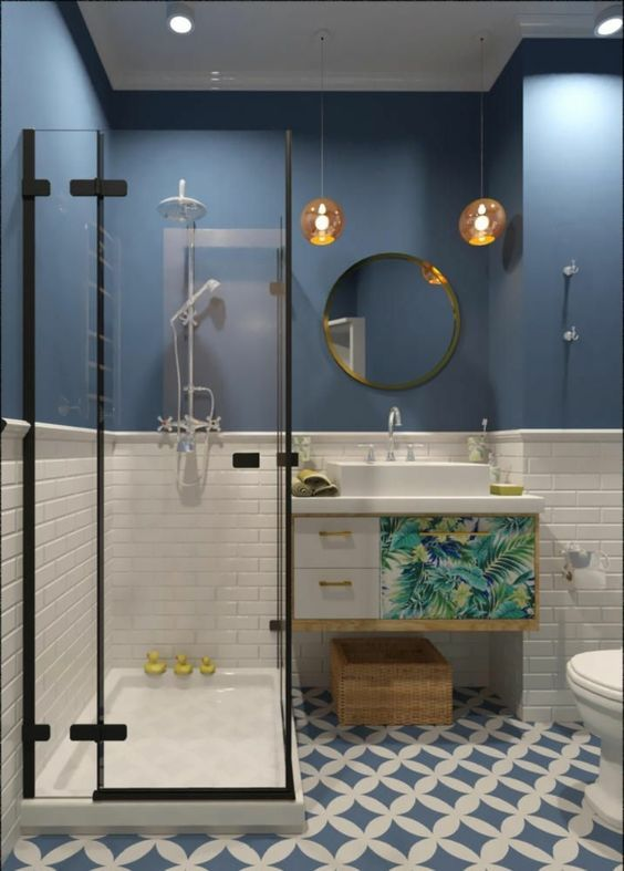 bathroom, patterned floor, white wall, blue wall, glass partition, round mirror, orange pendant, floating vanity with white top and sink